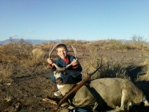 Dillon Wood with his first deer. Good Job Dillon!