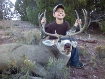 Christopher Sanchez on his first hunt with his first buck. One shot, one kill.