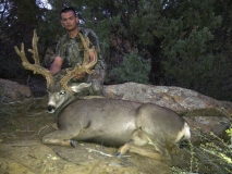 Jason Peace with the deer he harvested with a muzzleloader in September.