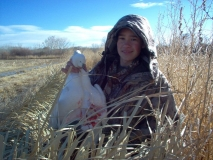 oah Cherry with the snow geese he collected during the Bosque Del Apache Youth Snow Goose hunt.