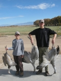 Canyon and Cody Young with the sandhill cranes they harvested while hunting on the Bernardo Waterfowl Management Area.