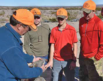 Tim Mitchusson, a retired Game and Fish biologist now with the Friends of the Bosque del Apache, shows youth hunters how to age their quail harvest. New Mexico Wildlife magazine, NMDGF