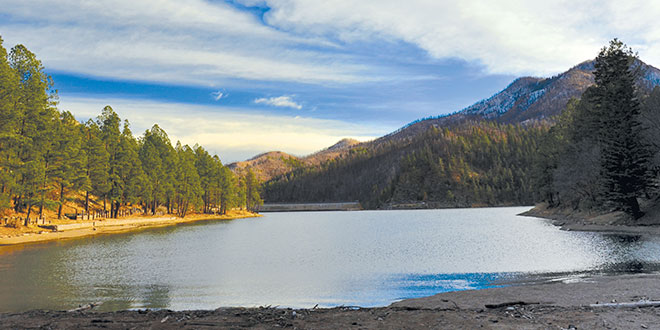 Bonito Lake, a popular trout fishing lake near Ruidoso, closed in 2012 after the Little Bear Fire. Reclammation work is scheduled to begin this fall. Photo by Karl Moffat, New Mexico Wildlife magazine, NMDGF.