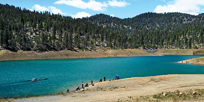 Grindstone Reservoir, nestled in the cool pine forest of the Sacramento Mountains, offers anglers in the southeastern portion of the state opportunities to wet a line for rainbow trout. Photo by Mark Madsen, New Mexico Wildlife magazine, NMDGF.