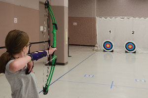 Sophie Walker, a fourth-grader at Maggie Cordova Elementary, got involved in archery when her mother got tired of buying Nerf bows and arrows and got Sophie the real thing.
