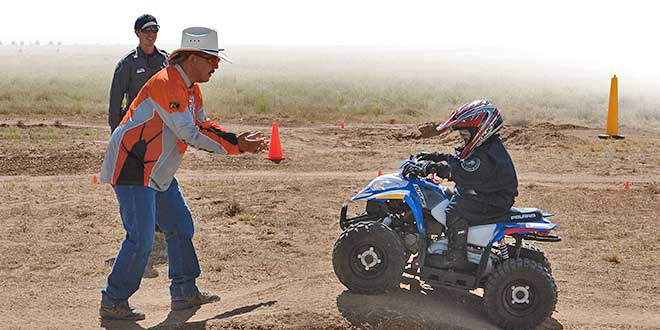 A volunteer off-highway vehicle instructor guides a your rider through a safety course. <em>NMDGF photo by Dan Williams.</em>