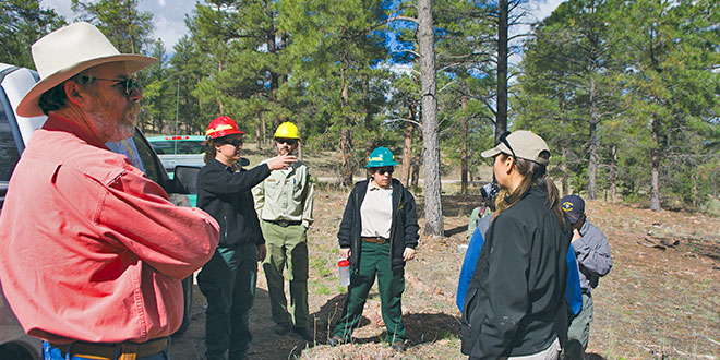 Scott Lerich, left, with the National Wild Turkey Federation, listens to a presentation from U.S. Forest Service personnel at one of the areas to have undergone restoration efforts in the Zuni Mountains. New Mexico Wildlife magazine, NMDGF.