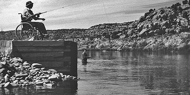 Navajo Dam created the excellent, and accessible, fishing on the Quality Waters of the San Juan River. Photo: NMDGF. New Mexico Wildlife magazine, Vol-49, Num-3 Fall 2004. (Making Tracks: A Century of Wildlife Management. (History of the New Mexico Department of Game and Fish).