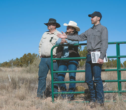 Ryan Darr, the Game and Fish lands program manager, examines an area now accessible to sportsmen and women as a result of the Open Gate program. Photo by Martin Perea, New Mexico Wildlife magazine, NMDGF.