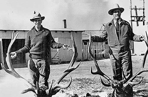 Elliott Barker, right, with lucky elk hunter. Photo: NMDGF. New Mexico Wildlife Magazine, Vol-48, Num-2 Summer 2003. (Making Tracks: A Century of Wildlife Management. (History of the New Mexico Department of Game and Fish).