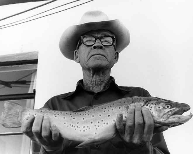 Proud fisherman shows off a nice brown trout. Photo: NMDGF. New Mexico Wildlife Magazine, Vol-49, Num-2 Summer 2004. (Making Tracks: A Century of Wildlife Management. (History of the New Mexico Department of Game and Fish).