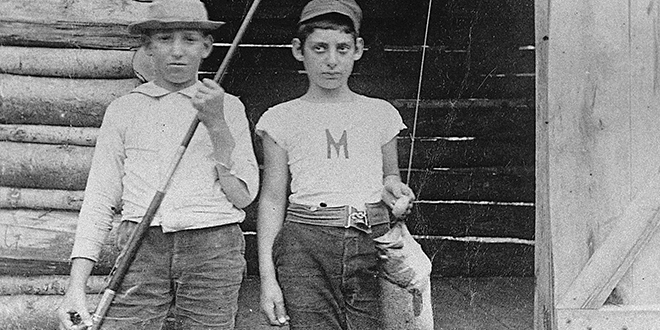 Two young fishermen with bass, 1899. Photo: New Mexico Records and Archives. (Making Tracks: A Century of Wildlife Management. New Mexico Wildlife magazine. (A history of the New Mexico Department of Game and Fish, NMDGF).