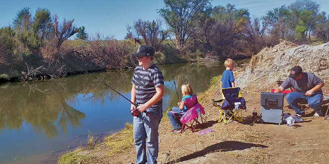 An area of the Berrendo River on the outskirts of Roswell offers a quality angling experience and now sports a parking area that can hold up to 30 vehicles. NMDGF photo by Tyson Sanders, New Mexico Wildlife magazine Spring 2017 Vol60, Num1, New Mexico Department of Game and Fish.