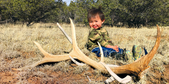 Shed hunting is a family-friendly activity that provides an opportunity to spend quality time outdoors. James Gonzales was out with his parents on a shed hunting expedition that resulted in the discovery of shed elk antlers. Photo by Joe Gonzales, New Mexico Wildlife magazine Spring 2017 Vol60, Num1, New Mexico Department of Game and Fish.