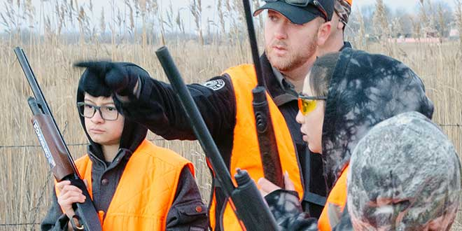 Lobato guides hunter education graduates on a youth pheasant hunt he organized. -NMDGF