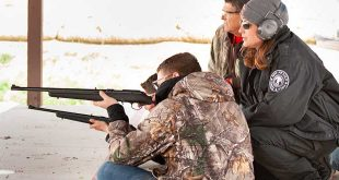 Jennifer Morgan, Hunter Education Coordinator for the Department, instructs a student on the proper sitting shooting position during a hunter education camp. Department photo by Martin Perea.